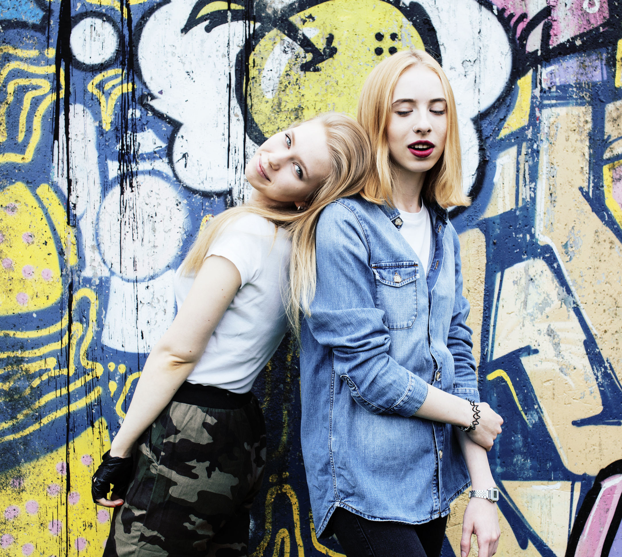 65386366 - two blonde real teenage girl hanging out at summer together best friends, lifestyle people concept close up